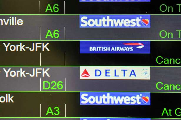 A flight board at Baltimore-Washington International Marshall Airport on April 1, 2020, shows that some flights to the New York area were canceled.