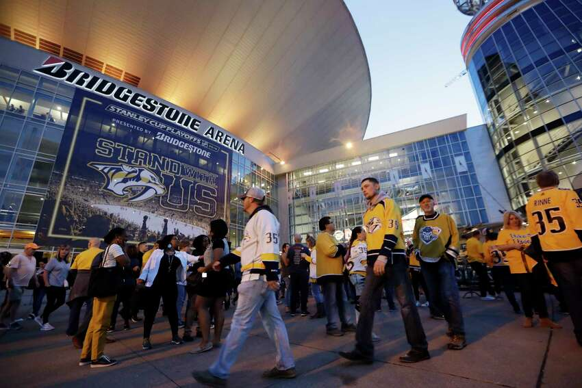 FILE - In this April 10, 2019, file photo, fans arrive at Bridgestone Arena for Game 1 of an NHL hockey first-round playoff series between the Nashville Predators and the Dallas Stars in Nashville, Tenn. It's unclear when or if the coronvirus pandemic-delayed NHL playoffs -- which were supposed to begin Wednesday -- will be played or what form they'll resemble. (AP Photo/Mark Humphrey, FIle)