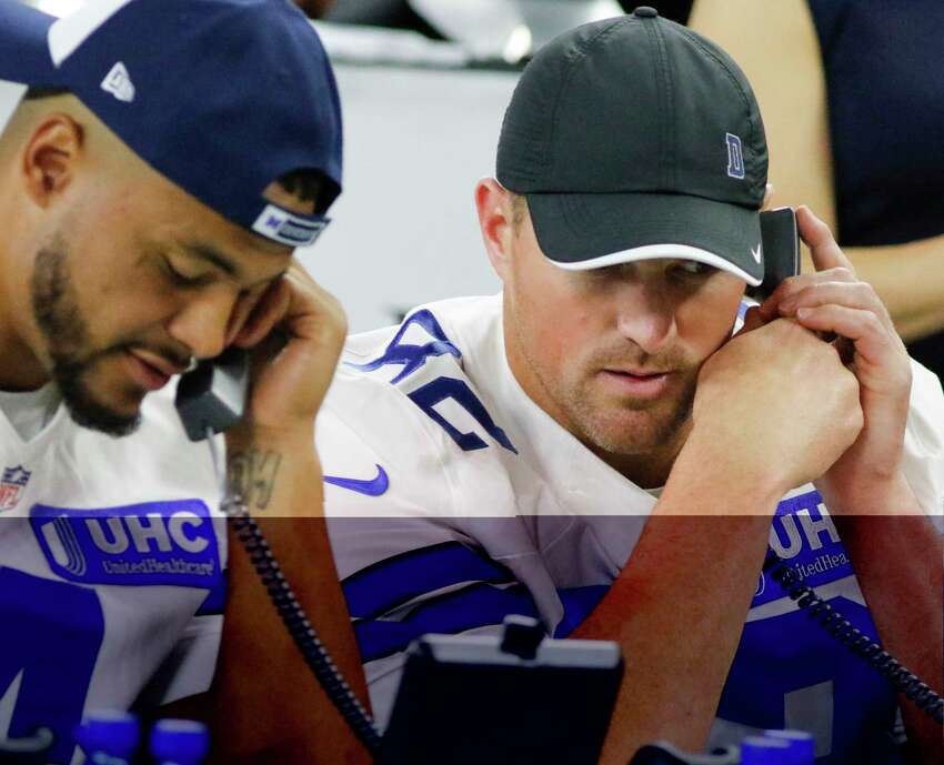 FILE - In this Aug. 31, 2017, file photo, Dallas Cowboys' Dak Prescott, left, and Jason Witten, right, take calls during The Salvation Army telethon at AT&T Stadium in Arlington, Texas. The NFL is planning a telethon to aid coronavirus relief efforts during the draft from April 23-25, 2020, according to two people familiar with the leaguea€™s plans. The people tell The Associated Press that the league hopes its massive reach will raise awareness and funds in battling the pandemic. They spoke to the AP on condition of anonymity because the telethon has not been announced publicly. (Ron Baselice/The Dallas Morning News via AP, File)