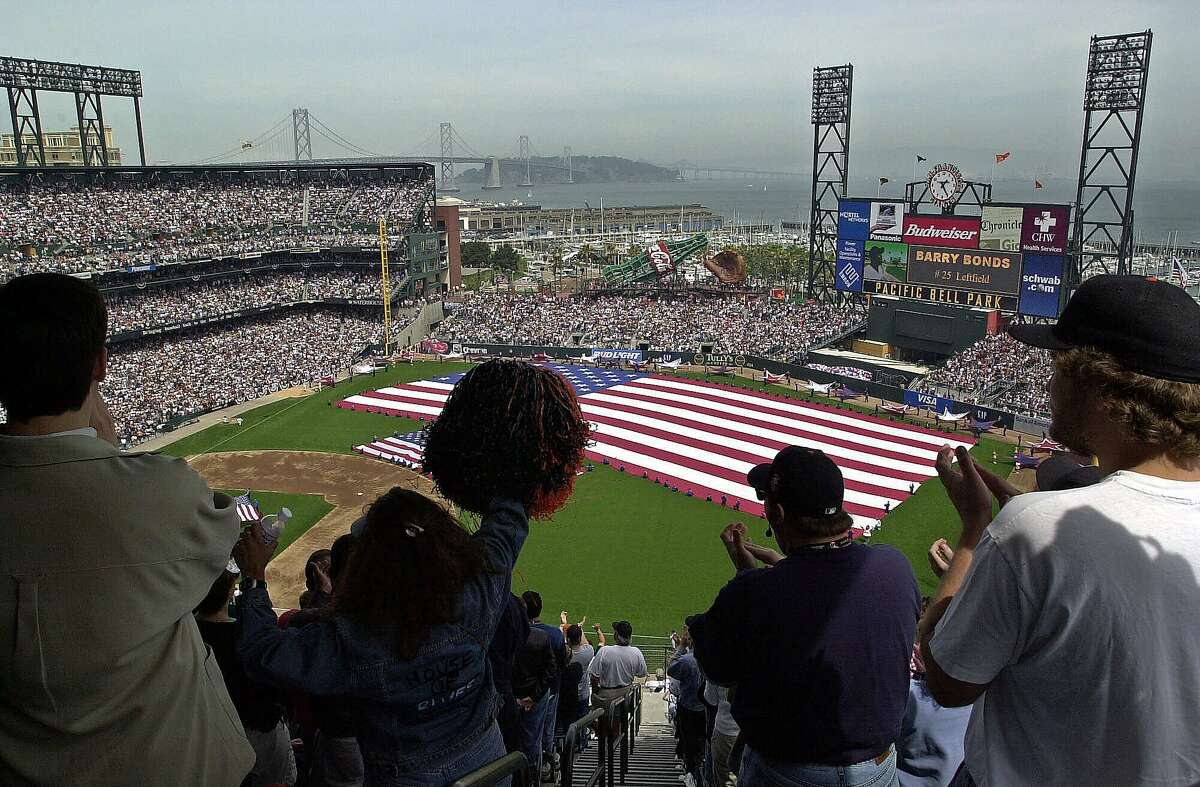 Fans cheer as the opening line-up is read for the first game played at Pacific Bell Park between the San Francisco Giants and the Los Angeles Dodgers on Tuesday, April 11, 2000, in San Francisco. (AP Photo/Ben Margot)