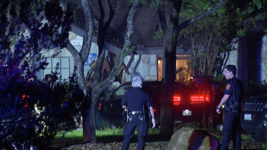 San Antonio police are searching for two men who they say ran from officers after crashing a stolen vehicle into a house on the North Side on Tuesday. Photo: Ken Branca