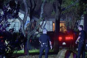 San Antonio police are searching for two men who ran from officers after crashing into a stolen vehicle into house on the North Side early Tuesday morning.