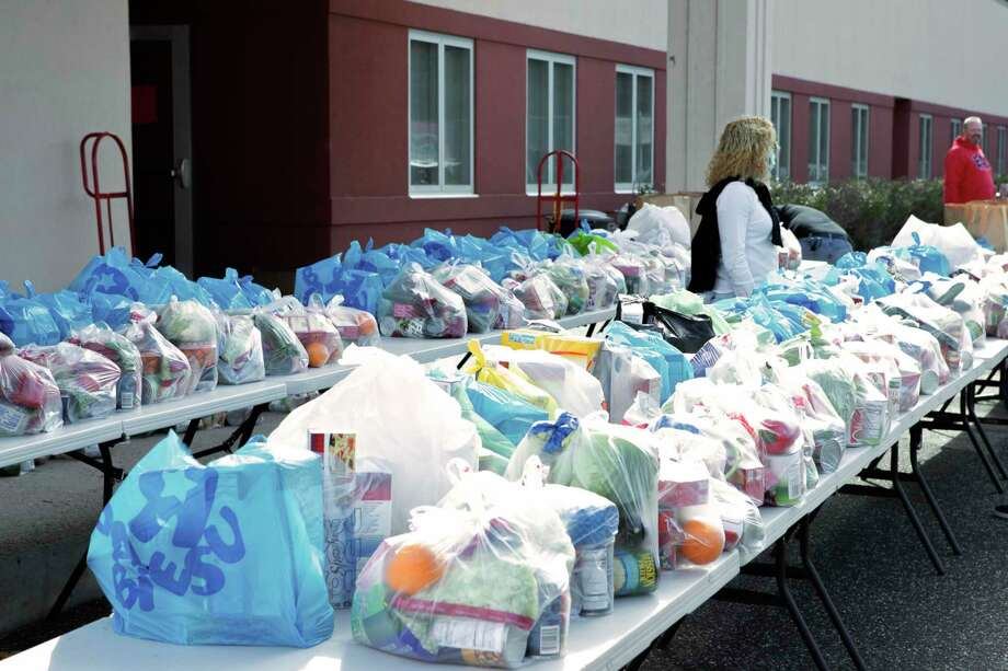 Local organizations in Washington are launching a new relief fund to help the state's food banks as they reach dangerously low supply levels amid the novel coronavirus outbreak. Photo: Courtesy Of Michele Roman Photography / The News-Times Contributed