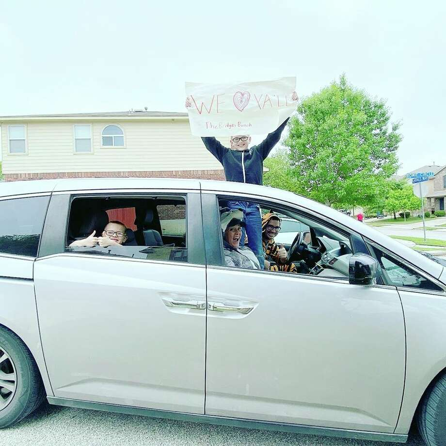 """While blasting """"We Like to Party!"""" by Vengaboys, a San Antonio family dressed up in funny costumes and drove around for two hours Sunday morning to throw bean and cheese tacos to teenagers from their youth group. Photo: Tilde-Edddie Benavides"""