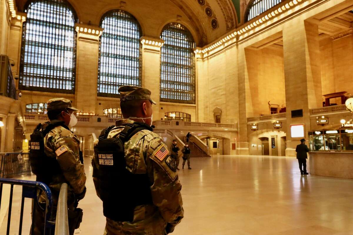 Members of the Joint Task Force Empire Shield, part of the New York State Division of Military and Naval Affairs, stand guard in New York's Grand Central Station on Wednesday, April 1, 2020.