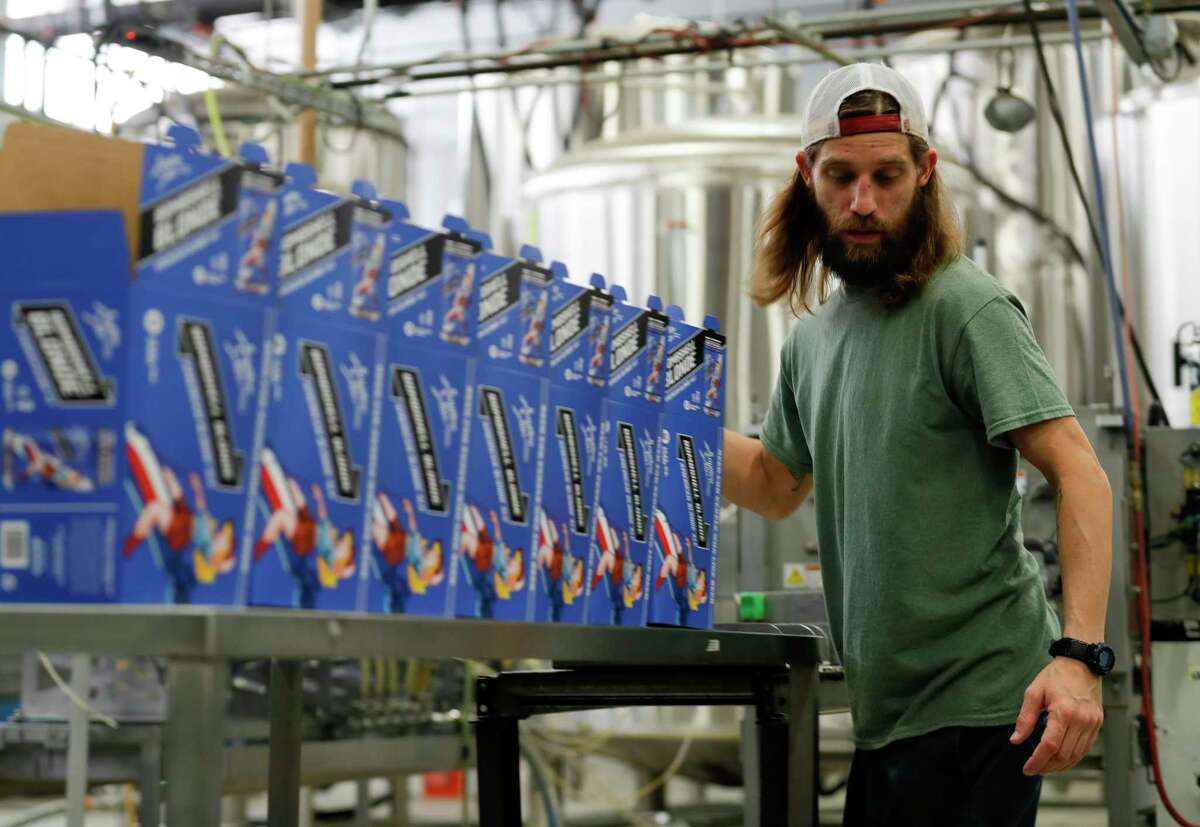Employees prepare boxes to store Southern Star Brewing's Bombshell Blonde, Friday, April 3, 2020, in Conroe.