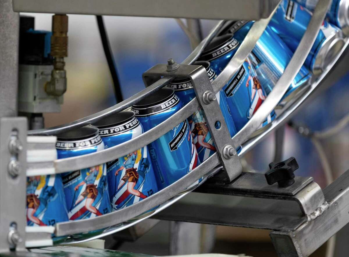 Cans of Southern Star Brewing's Bombshell Blonde are seen awaiting product, Friday, April 3, 2020, in Conroe.