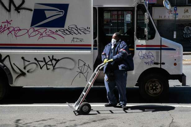 A postal worker wears a protective mask in New York City on April 6, 2020.