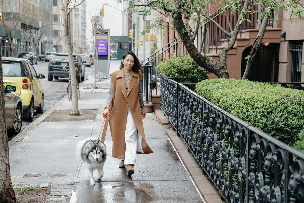 Fashion designer Nellie Partow walks her dog Mika in the West Village.