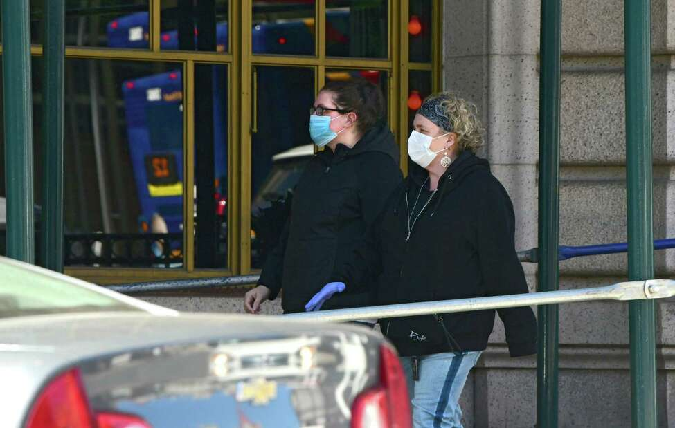 Pedestrians are seen wearing a protective mask as they walk down a sidewalk along State St. on Tuesday, April 7, 2020 in Albany, N.Y. (Lori Van Buren/Times Union)