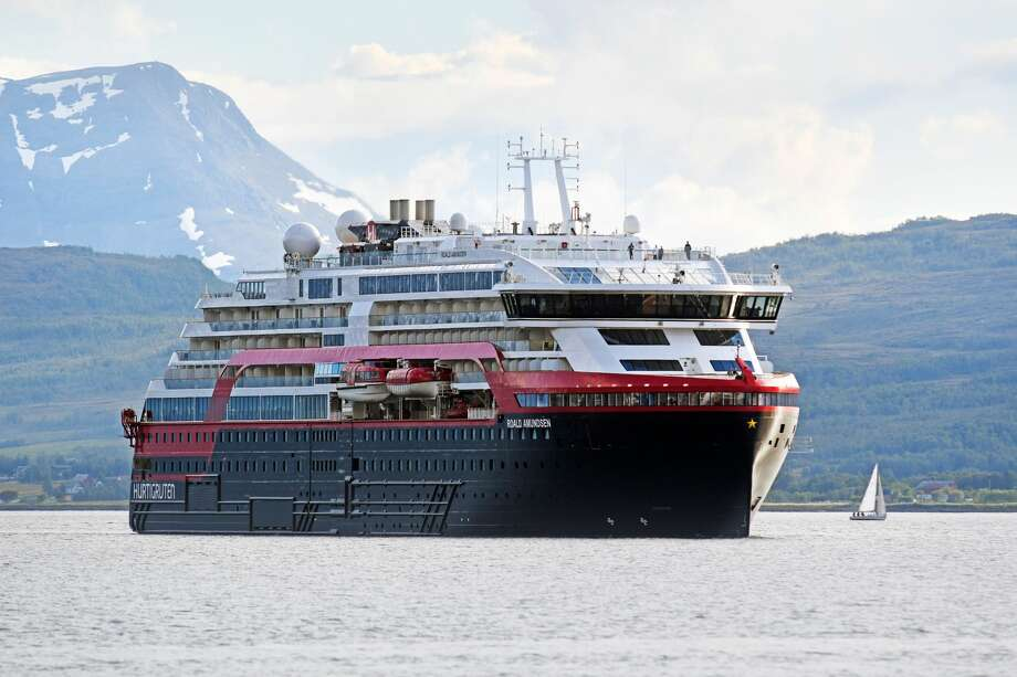 FILE - The MS Roald Amundsen cruise ship, the first of the new hybrid-powered expedition ships in Hurtigruten's fleet, arrives at Tromsoe, northern Norway on July 3, 2019. Photo: RUNE STOLTZ BERTINUSSEN/NTB Scanpix/AFP Via Getty Images