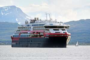 The MS Roald Amundsen cruise ship, the first of the new hybrid-powered expedition ships in Hurtigruten's fleet, arrives at Tromsoe, northern Norway on July 3, 2019.