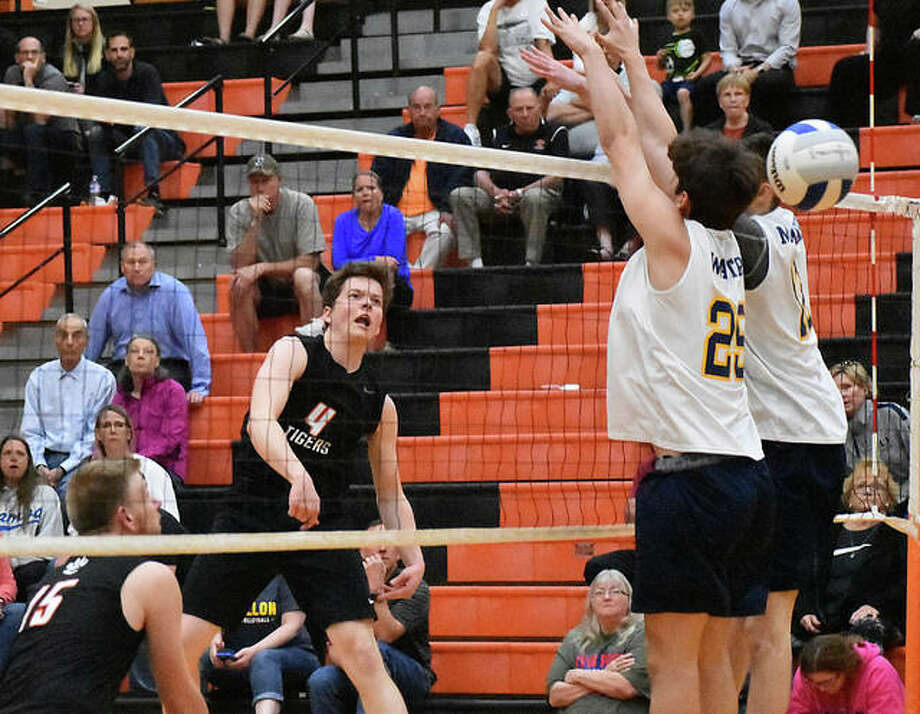 Edwardsville senior Max Sellers slams down a kill during a match against O'Fallon last season inside Lucco-Jackson Gymnasium. Photo: Matt Kamp|The Intelligencer
