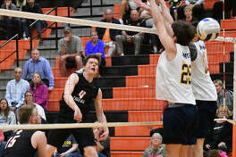Edwardsville senior Max Sellers slams down a kill during a match against O'Fallon last season inside Lucco-Jackson Gymnasium.