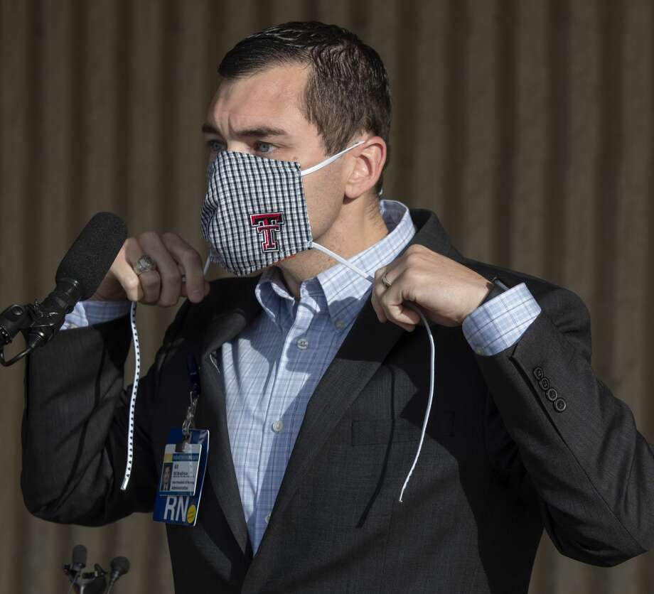 """Kit Bredimus, chief nursing officer at Midland Memorial Hospital, shows how to wear a homemade mask during the Unified Command Team press conference April 7 outside the Midland County Annex Building. He appeared before the city council last week to ask members and Mayor Patrick Payton """"to take a clear and unequivocal stance on the use of masks and other minimum standard health protocols."""" Photo: Tim Fischer/Midland Reporter-Telegram"""