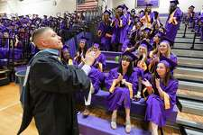 Principal Michael Rinaldi pumps up the crowd prior to Westhill High School Class of 2018 commencement exercises on June 22, 2018 in Stamford, Connecticut.