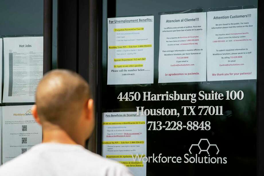 A man finds that the Workforce Solutions office is closed due to the Covid-19 outbreak, Wednesday, April 1, 2020, on Harrisburg in east Houston. Services are still available online and by phone, but the physical office is closed. Photo: Mark Mulligan, Houston Chronicle / Staff Photographer / © 2020 Mark Mulligan / Houston Chronicle