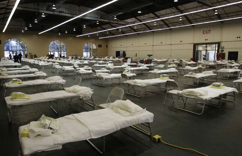 In this April 1, 2020, file photo, cots are set up at a possible COVID-19 treatment site in San Mateo, Calif. Photo: Ben Margot/Associated Press / Copyright 2020 The Associated Press. All rights reserved.