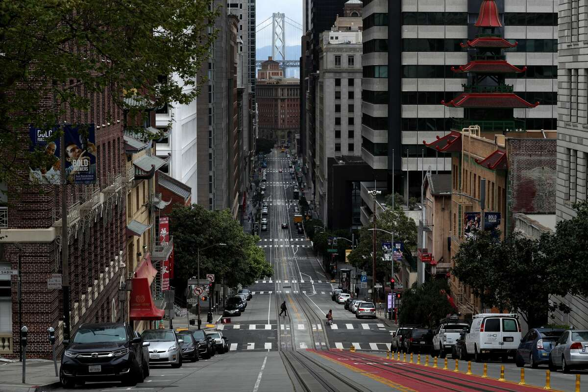 A pedestrian crosses an empty California Street during the coronavirus (COVID-19) pandemic on April 6, 2020 in San Francisco. Residents in the San Francisco Bay Area are continuing to shelter in place due to the coronavirus.