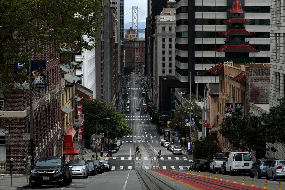 A pedestrian crosses an empty California Street during the coronavirus (COVID-19) pandemic on April 06, 2020 in San Francisco, California. Residents in the San Francisco Bay Area are continuing to shelter in place due to the coronavirus.
