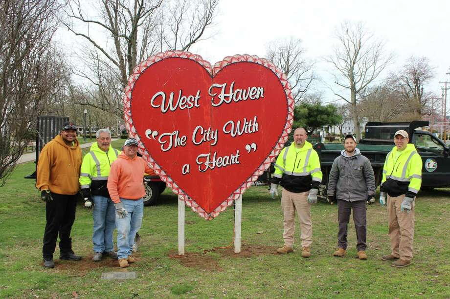 From left, West Haven Department of Park Maintenance employees Terrence Tucker, Jim Simeone, Dustin Werle, Shawn Doody, Chris Provost and Paul Blakeslee with a sign installed on the city Green. Photo: Contributed Photo