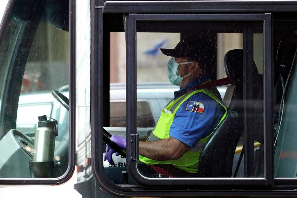 A VIA bus driver wears a protective mask and gloves as he drives through downtown San Antonio last week. Due to the COVID-19 outbreak, San Antonio and many other Texas cities are under stay at home orders. (AP Photo/Eric Gay)