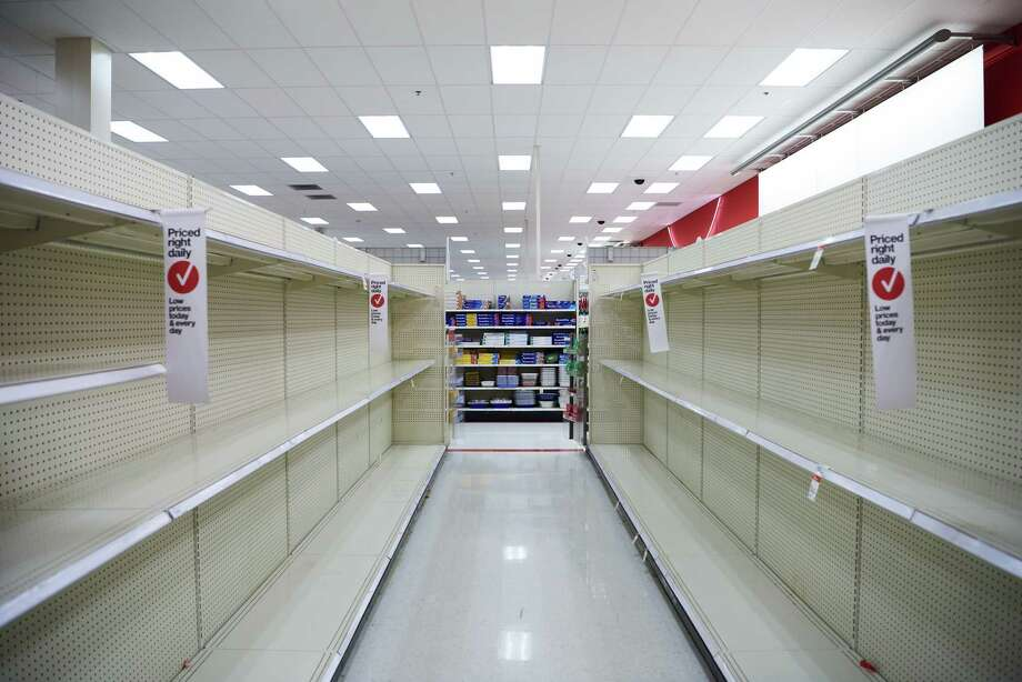 Shelves at the Target department store in Wadsworth, Ohio, were emptied of toilet paper and sanitizer a day after Ohio Gov. Mike DeWine put in place a stay-at-home order. Photo: Photo For The Washington Post By Dustin Franz / © 2020 Dustin Franz