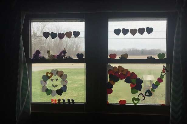 Inspired by the Facebook page #aworldofhearts, Public Arts Midland reached out toMidlanders, asking to see local window artthey'recreated while sheltering in place. (Photo Provided/Annie Stout & Public Arts Midland)