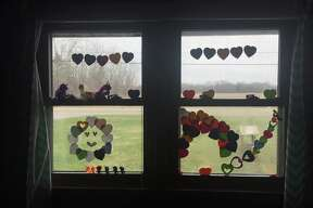Inspired by the Facebook page #aworldofhearts, Public Arts Midland reached out to Midlanders, asking to see local window art they're created while sheltering in place. (Photo Provided/Annie Stout & Public Arts Midland)