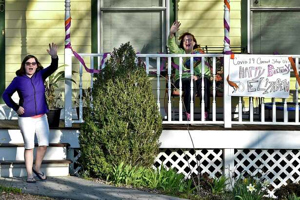 A surprise parade of cars slowly drove by the Orange home of Elizabeth Romanovsky, 15, celebrating her 15th birthday April 06, 2020 in lieu of a party to comply with the social distancing protocol during the coronavirus / Covid-19 pandemic.