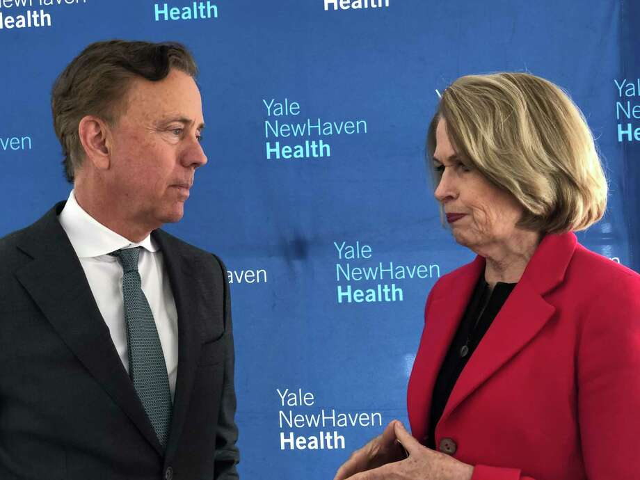 Gov. Ned Lamont, left, speaks with Marna Borgstrom, CEO of Yale New Haven Health and Yale New Haven Hospital, at a press conference in 2019. Photo: Ed Stannard / Hearst Connecticut Media File
