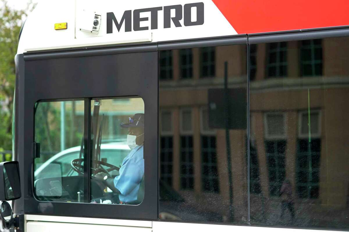 A Metropolitan Transit Authority bus driver is shown wearing a mask amid the coronavirus pandemic on April 6 in Houston.