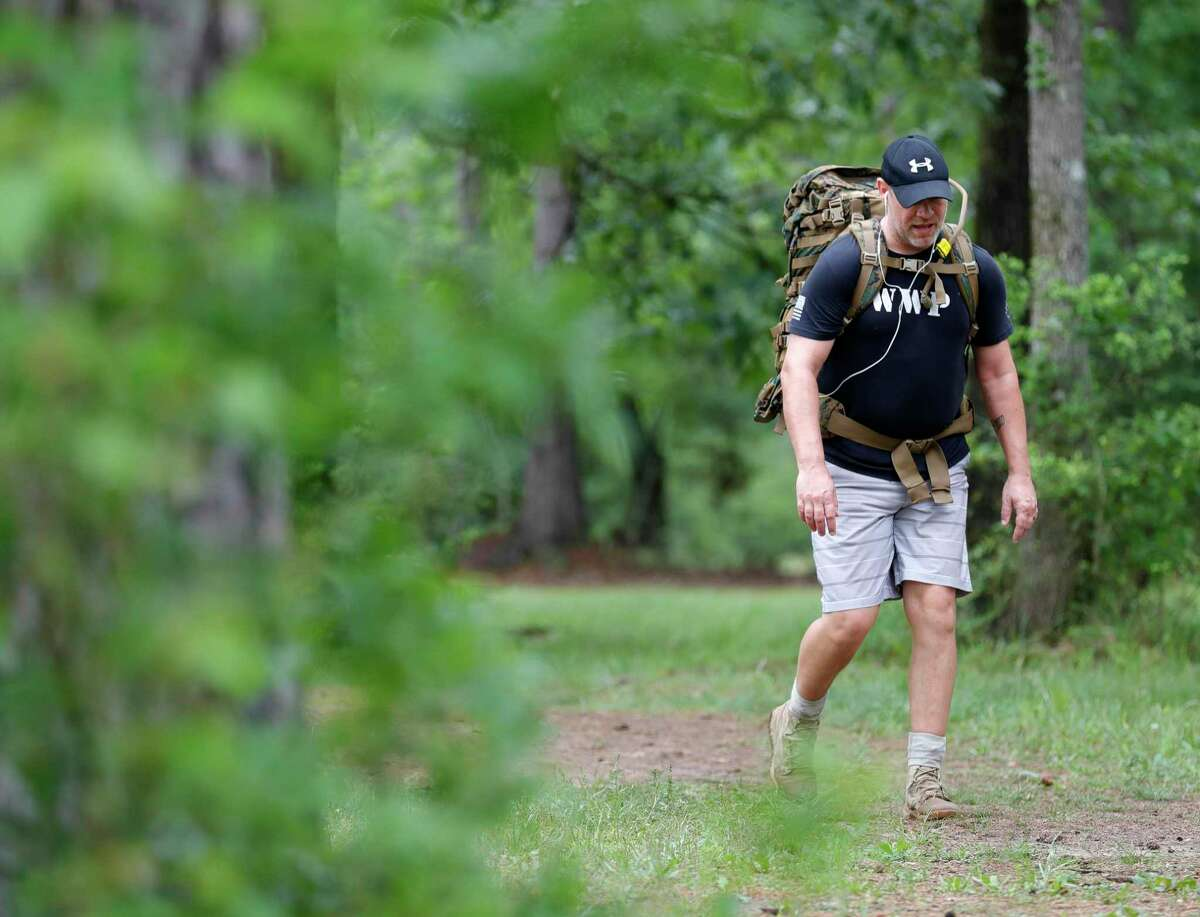 Chris Josephson trains for his return to the U.S. Army by hiking with a backpack at William Goodrich Jones State Forest. Governor Greg Abbott announced Tuesday all state parks, including Jones State Forest, would be closed to minimize the spread of the new coronavirus.