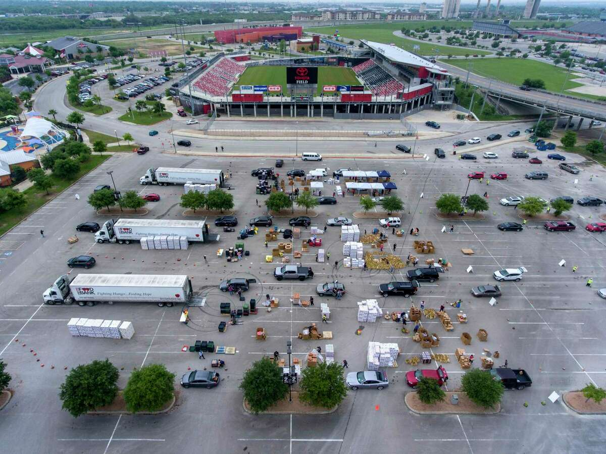 Vehicles pass through the Food Bank's temporary distribution center at Toyota Field on Tuesday, April 7. Demand for food aid has skyrocketed since the start of the COVID-19 coronavirus pandemic.