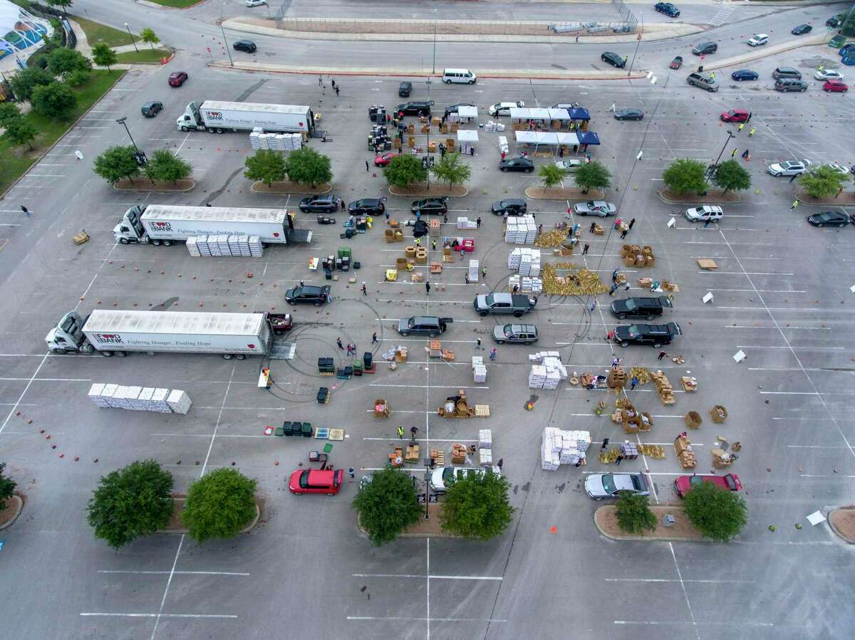 An aerial view at Toyota Field shows the jam-packed parking lot as vehicles pass through the Food Bank's temporary distribution center Tuesday. Demand for food aid has more than doubled as the pandemic-fueled recession takes hold.