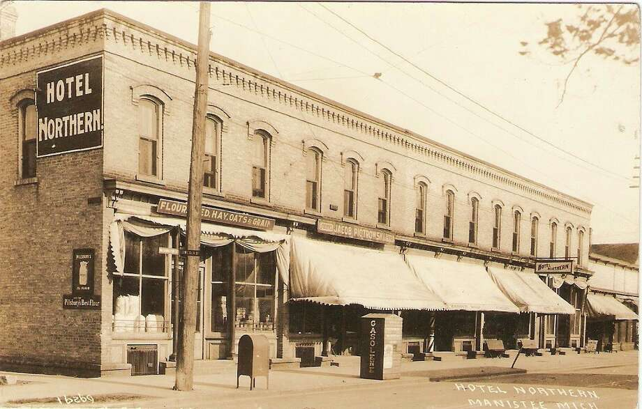 The Hotel Northern building is shown in this 1920s photo when it was filled with a variety of businesses. The building still stands today on Washington Street in Manistee.