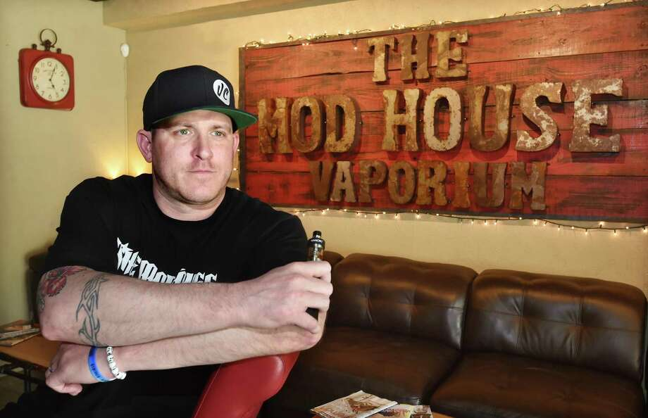 Kurt Buckholz, owner of The Mod House Vaporium, at 113 River Street in Milford is photographed at his Milford vaping bar which is being sued for selling batteries that exploded, injuring a Bridgeport man. Photo: Catherine Avalone / / New Haven RegisterThe Middletown Press