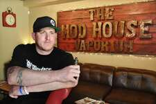 Kurt Buckholz, owner of The Mod House Vaporium, at 113 River Street in Milford is photographed at his Milford vaping bar which is being sued for selling batteries that exploded, injuring a Bridgeport man.