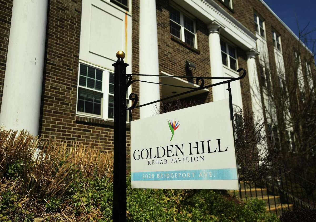 File photo showing a sign outside the Golden Hill Rehab Pavilion nursing home at 2028 Bridgeport Avenue in Milford, Conn., taken on Tuesday, April 7, 2020. The facility has 82 residents with lab-confirmed cases of COVID-19. The facility also reported 24 confirmed and probable deaths linked to the virus.