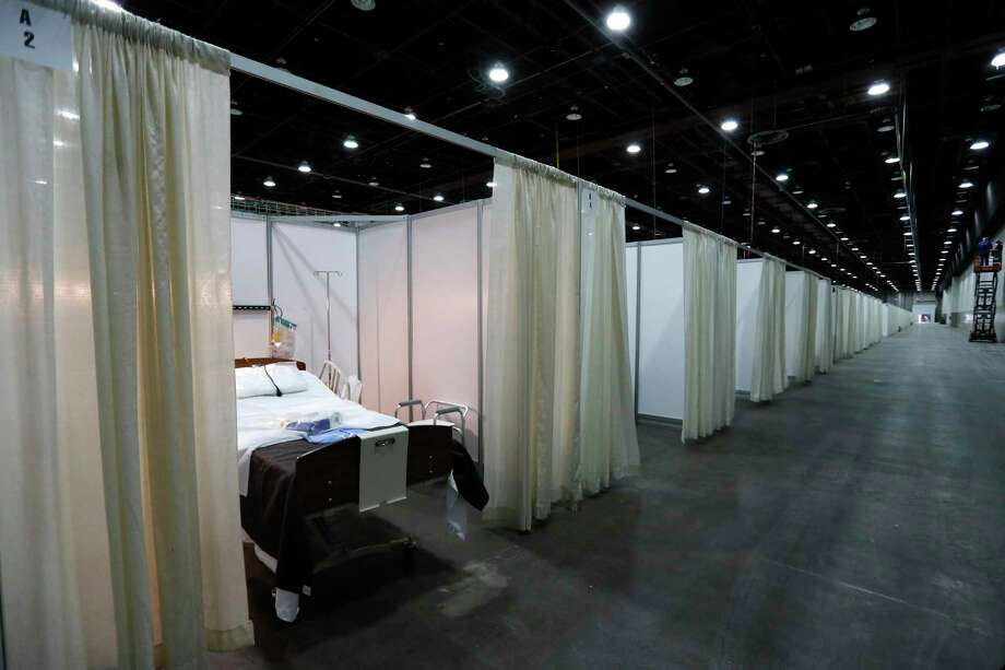 This photo shows a hospital bed in one of the temporary rooms at the TCF Center, Monday, April 6, 2020, in Detroit. The city's convention center was converted to accommodate an overflow of patients with the coronavirus. The U.S. Army Corps of Engineers began construction at the TCF Center to create a quarantined hospital setting with 1,000 beds as the pandemic spreads rapidly in the city. (AP Photo/Carlos Osorio) / Copyright 2020 The Associated Press. All rights reserved.
