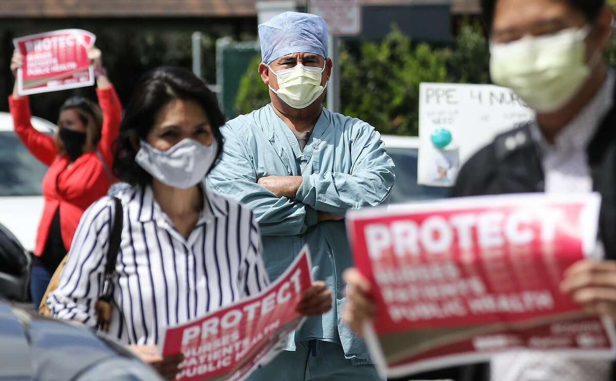 ORANGE, CALIFORNIA - APRIL 03: Nurses and supporters protest about the lack of personal protective gear available at UCI Medical Center amid the coronavirus pandemic on April 3, 2020 in Orange, California. Hospitals nationwide are facing shortages of PPE due to the COVID-19 outbreak. (Photo by Mario Tama/Getty Images)