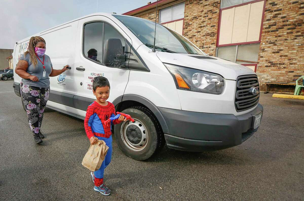 Kids Meals Inc, driver, Susie Bell said she is happiest when she gets to see how happy children are to receive meals as she made her deliveries Tuesday, April 7, 2020, in Houston. Kids Meals Inc, a non-profit that delivers meals to pre-school age children who live in underserved communities.