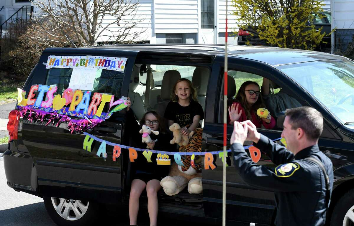 Friends and well wishers parade past Annabelle Carroll's home to celebrate her eleventh birthday on Tuesday, April 7, 2020, on Sycamore Street in Albany, N.Y. Carroll, who suffers from autism, was delighted to see an Albany fire truck and several Albany police cars join her parade. (Will Waldron/Times Union)
