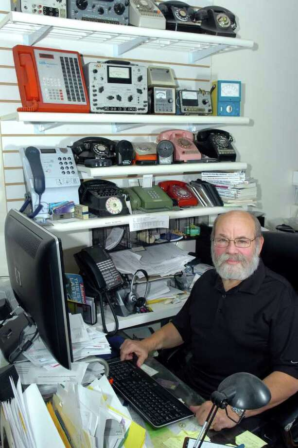 Michael N. Marcus, President of AbleComm Inc. sits at his desk at the Phone Geeks store in Milford, Conn. Aug. 19th, 2010. Photo: Ned Gerard / Connecticut Post