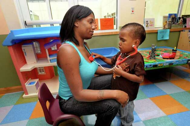Jihaad Griffin, 3, a patient in the hospital, plays