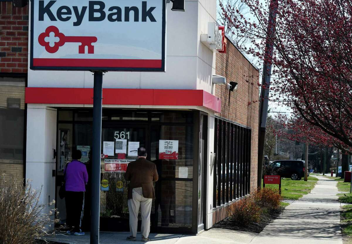 People wait outside to use services at a Key Bank branch during coronavirus lockdown on Tuesday, April 7, 2020, on New Scotland Avenue in Albany, N.Y. (Will Waldron/Times Union)