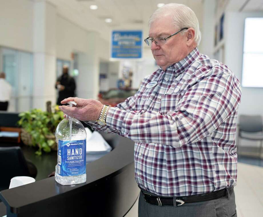 Donnie Buckalew, General Manager of Buckalew Chevrolet, disinfects his hands with sanitizer, Thursday, April 2, 2020. The dealership has seen a decline in prospective car buyers through in-person visits, online web traffic and phone calls. Photo: Gustavo Huerta, Houston Chronicle / Staff Photographer / Houston Chronicle © 2020