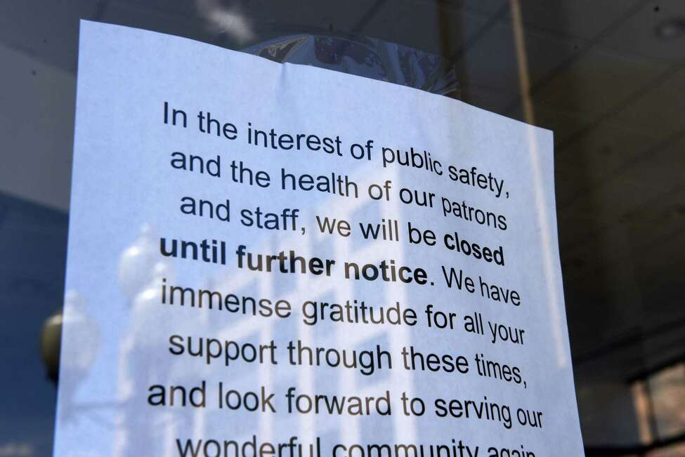 A sign in the door of Stacks Espresso Bar on Broadway states that they are closed during the coronavirus lockdown on Tuesday, April 7, 2020, in Albany, N.Y. (Will Waldron/Times Union)
