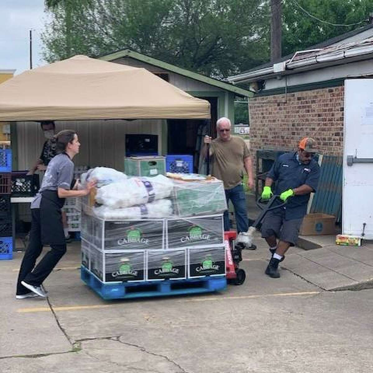 Pantry items are brought in to help Cypress Assistance Ministries meet the area's growing need for food assistance during the ongoing coronavirus pandemic.