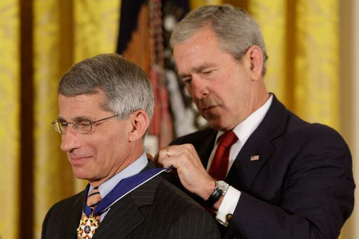 President Bush places the Presidential Medal of Freedom on Dr. Anthony S. Fauci, director of the National Institute of Allergy and Infectious Diseases, as he takes part in a ceremony for the 2008 recipients of the Presidential Medal of Freedom, Thursday, June 19, 2008, in the East Room at the White House in Washington. Fauci is a native of Brooklyn.